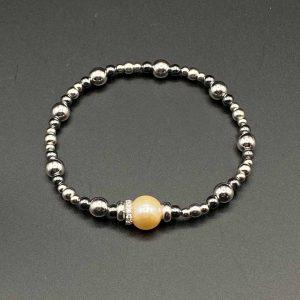 Bracciale donna elastico con perla centrale ambrata e catenina in ematite e argento BR9820